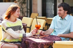 Couple at cafe table, outdoors. Italy, Europe Stock Images