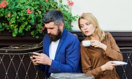 Couple cafe terrace drink coffee. Couple in love sit cafe terrace enjoy coffee. Man secret messaging cheating on wife royalty free stock images