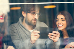 Couple In Cafe Using Technology Royalty Free Stock Photography