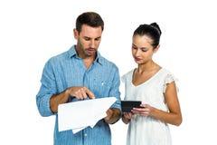 Couple calculating bills Stock Photos