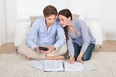 Couple calculating budget at home Royalty Free Stock Photo