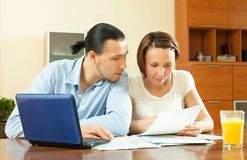 Couple calculating family budge Stock Photos