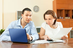Couple calculating family budget Stock Images