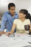 Couple Calculating Finance At Home Royalty Free Stock Photography
