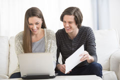 Couple Calculating Finance At Home Royalty Free Stock Photos