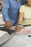 Couple Calculating Financial Budget Royalty Free Stock Photos