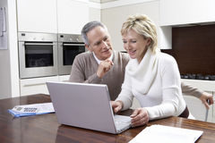 Couple Calculating Home Finances On Laptop Stock Photography