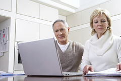 Couple Calculating Home Finances On Laptop Royalty Free Stock Photos