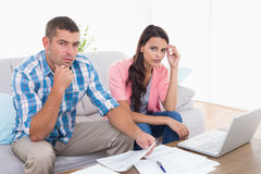 Couple calculating home finances together in house Royalty Free Stock Photo