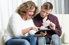 Couple is calculating lottery win Stock Photography