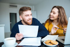Couple calculating their bills at home Royalty Free Stock Image