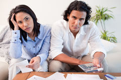 Couple calculating their costs Royalty Free Stock Image