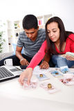Couple calculating their domestic bills Stock Photo