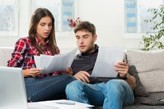Couple calculating their domestic bills at home Royalty Free Stock Photo