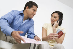 Couple Calling About Credit Card Bill Royalty Free Stock Photo