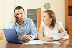 Couple calling by mobile about  documents Royalty Free Stock Image