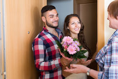 Couple came to mother with flowers Royalty Free Stock Photography