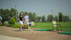 The couple came to play golf at the golf club stock video