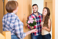 Couple  came to visit mother at the parental home Stock Photos