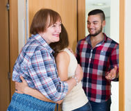 Couple  came to visit mother at the parental home. American adult couple  came to visit mother at the parental home Royalty Free Stock Image