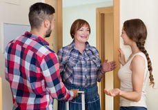 Couple  came to visit mother at the parental home. Happy american young couple  came to visit mother at the parental home Royalty Free Stock Image