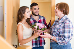 Couple  came to visit mother at the parental home. Happy european young couple  came to visit mother at the parental home Royalty Free Stock Photo