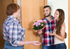 Couple  came to visit mother at the parental home. Russian couple  came to visit mother at the parental home Royalty Free Stock Photo