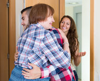 Couple  came to visit mother at the parental home. Russian adult couple  came to visit mother at the parental home Royalty Free Stock Images