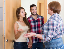 Couple  came to visit mother at the parental home. Smiling adult couple  came to visit mother at the parental home Royalty Free Stock Photos