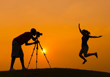 Couple Camera Jumping Hill Concept Royalty Free Stock Image