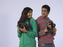 Couple With Cameras In Studio Stock Photos