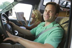 Couple in camper van Stock Photography