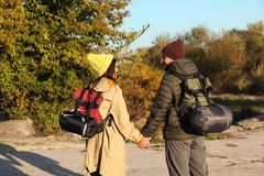 Couple of campers with backpacks and sleeping bags. In wilderness royalty free stock images