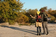 Couple of campers with backpacks and sleeping bags in wilderness. Space for text stock images