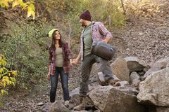 Couple of campers with sleeping bag. In wilderness stock photography