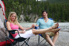 Couple camping. Enjoying each others company Stock Images