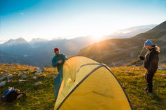 Couple camping. With tent in mountains Stock Image