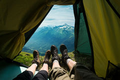 Couple camping. In mountains view from a tent Royalty Free Stock Photos