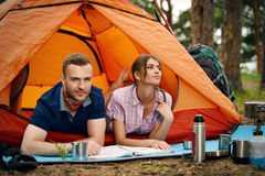Couple in camping. Happy couple having a rest in a camp tent. Hiking, camping stock photos
