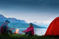 Couple camping. A couple camping near seaside royalty free stock image