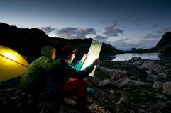 Couple camping at night royalty free stock photos
