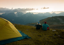 Couple camping at night royalty free stock image