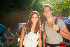 Couple on camping. Portrait of a young hikers with backpacks royalty free stock photo