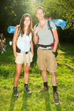 Couple on camping. Portrait of a young hikers with backpacks royalty free stock photos