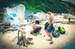 Couple camping on sandy beach