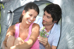Couple camping in tent Stock Image