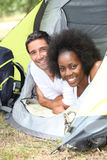 Couple camping in tent Royalty Free Stock Image