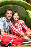 Couple camping in tent happy in romance Stock Photography