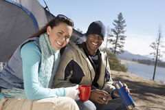 Couple At Campsite With Thermos Stock Photo