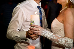Wedding couple and candle Stock Image